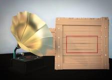 Gramófono y una caja de madera llena Imagenes de archivo
