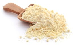 Gram flour. Closeup over white background stock image