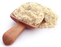 Gram flour. In wooden scoop over white background stock images
