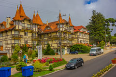 GRAMADO, BRAZIL - MAY 06, 2016: nice hotel built in a german style with yellow walls, wood columns and red roof tiles Royalty Free Stock Photo