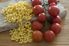 Gramigna and cherry tomatoes Stock Image