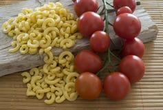 Gramigna i czereśniowi pomidory Obraz Stock