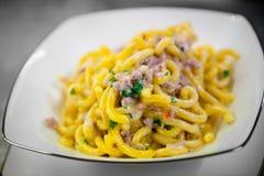 Gramigna (italian pasta) with pork sausage Royalty Free Stock Images