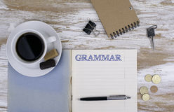 Grammar - Copybook on the desktop. Royalty Free Stock Photography