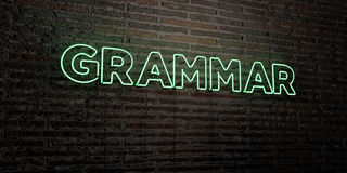 GRAMMAR -Realistic Neon Sign on Brick Wall background - 3D rendered royalty free stock image Royalty Free Stock Images