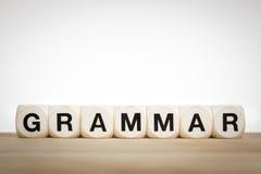 Grammatikkonzept mit Spielzeugwürfeln Stockfotos
