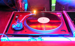 Gramophone. Night Club and vinyl plate, gramophone, colors, lights Stock Photography