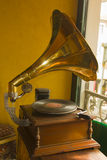 Gramophone. Antique gramophone on a table next to the window stock photo
