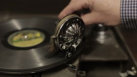 Gramophone in the antique shop. Antique disc rotates on the gramophone in the antique shop stock video