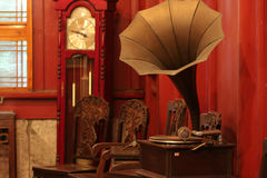 Gramophone and clock. Vintage chinese gramophone and clock Stock Photos