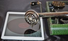 Gramophone and ipad innovative cooperation Stock Image