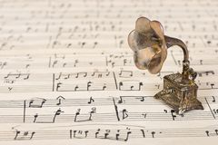 Gramophone on old sheet music Royalty Free Stock Images