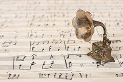 Gramophone on old sheet music. Retro art background Royalty Free Stock Images