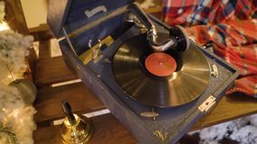 Gramophone plays christmas songs on vinyl record. Phonograph plays old music song on vinyl plate.  stock video footage