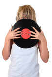 Gramophone record. Girl with gramophone record, only eyes visible Stock Photos