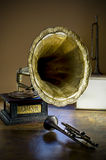 Gramophone and Trumpets. Beautifully lit still life scene of an old gramophone and two trumpets stock photo