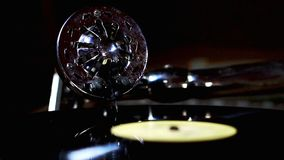 Gramophone vintage with head turntable and twisting vinyl record. Needle turntable on spinning vinyl record. Gramophone retro playing musical song on vinyl stock footage