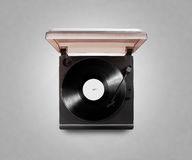 Gramophone vinyl player playing record, top view, , clipping path. Stock Photos