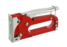 Grampeador vermelho do carpinteiro na posição da segurança imagens de stock royalty free