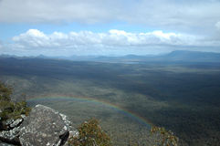 The Grampians. A view of a forest from mountain top with a rainbow Royalty Free Stock Photos