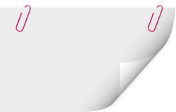 Grampo de papel que prende uma folha do papel em branco Imagens de Stock