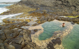Gran Canaria, Banaderos area, rock pools. Gran Canaria, Banaderos area, naturist is bathing in rock pools royalty free stock photography