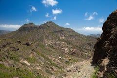 Gran Canaria, Barranco de Soria. Gran Canaria, hiking route Cruz Grande - Llanos de la Pez, steep footpath, camino real, against the wall of the valley Stock Photo