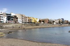 Gran Canaria - Beach of Arguineguin, spring day on Atlantic coastline, Canary Islands, Spain. Gran Canaria, Spain - March 14, 2019:  Arguineguin, people enjoy royalty free stock image