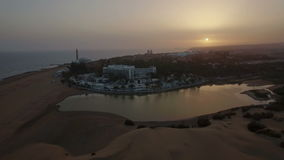 Gran Canaria coast with resort at sunset stock footage