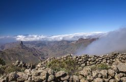 Gran Canaria, February. Gran Canaria, Las Cumbres, the highest areas of the island, February, clouds flowing into Caldera de Tejeda stock photo