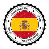 Gran Canaria flag badge. Vintage travel stamp with circular text, stars and island flag inside it. Vector illustration Stock Photo