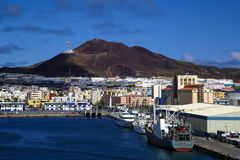 Gran Canaria Harbour. A view of the Harbour in Gran Canaria with ships moored along the pier and the city of las palmas in the background stock image