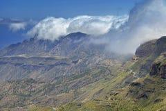 Gran Canaria, May. Hiking route Cruz de Tejeda - Artenara, view into Caldera de Tejeda, clouds rolling from the right royalty free stock photography