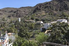 Gran Canaria, the mountain village of Fataga, whitewashed Canarian houses with brown clay roof tiles.  Canary Islands, Spain. Fataga is one of the most perfectly royalty free stock photos