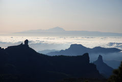 Gran Canaria mountains 1. Mt Teide in Tenerife from Gran Canaria with Roque Nublo in the foreground stock image