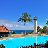 Gran Canaria resort. Scenic view of the lighthouse and swimming pool inside of tropical resort in the Playa del Aguila. Gran Canaria is one of the most popular stock photos