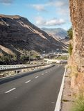 Gran Canaria road into the mountains. An open road leading into the rocky volcanic mountains found on the Canary Island of Gran Canaria royalty free stock images
