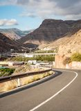 Gran Canaria road into the mountains. An open road leading into the rocky volcanic mountains found on the Canary Island of Gran Canaria royalty free stock photography