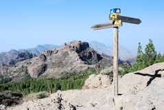 Gran Canaria, rough landscape, mountains, footpath signpost, blue sky Stock Photo