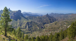 Gran Canaria, view across Caldera de Tejeda. Towards Roque Bentayga, top of Teide on Tenerife visible above mist, Roque Nublo to the left Royalty Free Stock Images