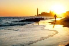 Gran Canaria. View of beach and lighthouse Maspalomas at sunset. Gran Canaria stock photo