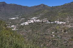 Gran Canaria,view of mountain countryside and village of Tejeda, white Canarian houses with brown clay roof tiles.  Canary Islands. Tejeda located in the centre stock image
