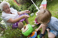 Gran and gran children playing outside royalty free stock photography