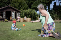 Gran and grandson play ball Stock Photography