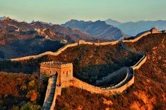 Gran Muralla en la puesta del sol Foto de archivo
