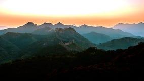 Gran Muralla en la puesta del sol Imagen de archivo libre de regalías