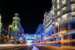 Gran Via Street in Madrid at night on Christmas time with lighti. Madrid, Spain - December 8, 2017: Gran Via Street in Madrid at night on Christmas time. Long Royalty Free Stock Photo