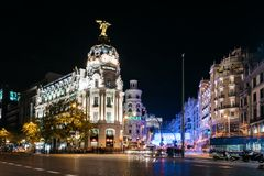 Gran Via Street in Madrid at night on Christmas time with lighti. Madrid, Spain - December 8, 2017: Gran Via and Alcala streets in Madrid at night on Christmas Stock Images