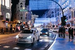Gran Via Street in Madrid at night on Christmas time with lighti. Madrid, Spain - December 8, 2017: Traffic in Gran Via Street in Madrid at night on Christmas Royalty Free Stock Image