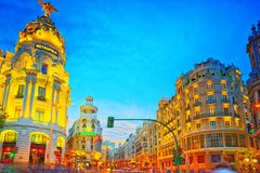 Gran Via Street in Madrid, after sunset, traffic lights on Gran. Madrid, Spain - June 04, 2017 : Gran Via Street in Madrid, after sunset, traffic lights on Gran Stock Image